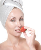 Beautiful young woman in towel, with a berry Royalty Free Stock Images