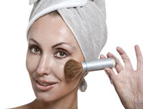 Beautiful young woman in towel with a brush for a make-up Royalty Free Stock Photos