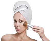 Beautiful young woman in towel with a brush for a make-up Royalty Free Stock Images