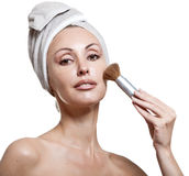Beautiful young woman in towel with a brush for a make-up Royalty Free Stock Photography
