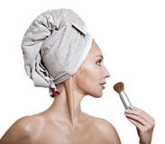 Beautiful young woman in towel with a brush for a make-up Stock Images