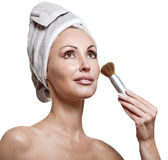 Beautiful young woman in towel with a brush for a make-up Stock Photography