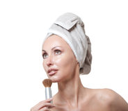 Beautiful young woman in towel with a brush for a make-up Royalty Free Stock Image