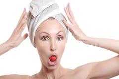 Beautiful young woman in towel Stock Photos