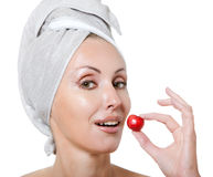 Beautiful young woman in towel, with a cherry berry Royalty Free Stock Image