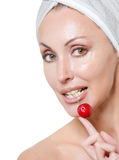 Beautiful young woman in towel, with a cherry berry Royalty Free Stock Photography