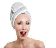 Beautiful young woman in towel, with a cherry berry Stock Photos