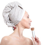 Beautiful young woman in towel with a cosmetic brush Royalty Free Stock Image