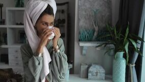 Beautiful young woman with towel on head drink coffee in the morning