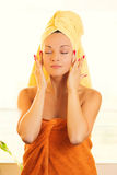 Beautiful young woman with towel on head Royalty Free Stock Images