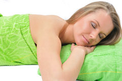 Beautiful young woman in towel lying on floor Royalty Free Stock Photography