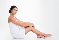 Beautiful young woman in towel sitting on the floor Royalty Free Stock Image