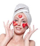 Beautiful young woman in towel with a strawberry mask Stock Images