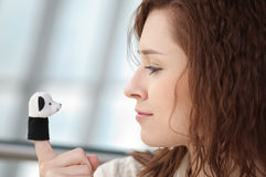 Beautiful young woman with a toy Royalty Free Stock Photo