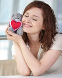 Beautiful young woman with a toy Stock Photo