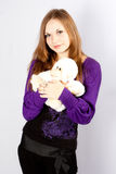 Beautiful young woman with a toy a monkey Royalty Free Stock Photo