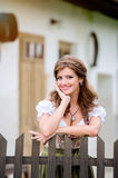 Beautiful young woman in traditional bavarian dress in park Royalty Free Stock Images