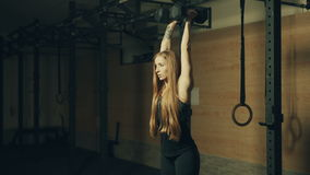 Beautiful young woman training with dumbbells in gym stock footage