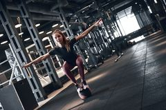 Woman Fitness. Beautiful young woman while training in the gym stock images