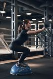 Woman Fitness. Beautiful young woman while training in the gym stock photo