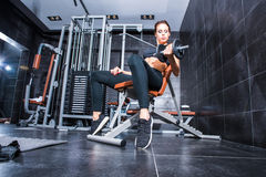 Beautiful Young woman training in the Gym Stock Photos
