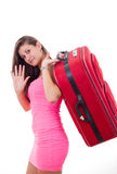 Beautiful young woman with travel suitcase saying goodbuy Stock Images