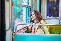 Beautiful young woman travelling in a train of Parisian subway stock photos