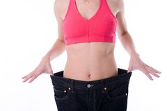Beautiful young woman trying pants after diet weight loss program Royalty Free Stock Images