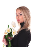 Beautiful young woman with tulips Stock Photo