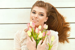Beautiful young woman with tulips Stock Image