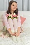 Beautiful young woman with tulips Royalty Free Stock Photo