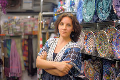 Beautiful young woman in a Turkish shop. Beautiful young woman in a Turkish gift shop royalty free stock images