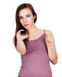 Beautiful young woman with TV remote control Stock Photo
