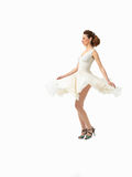 Beautiful young woman twirling in white dress Stock Photo
