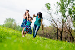 Beautiful Young Woman with Two Children in the park. Happy family outdoors. women and two children having fun.Summer. Mother and daughter in the park. Happy Royalty Free Stock Photos