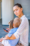 Beautiful young woman with two kids Stock Photography