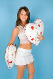 Beautiful young woman with two pillows Royalty Free Stock Photos