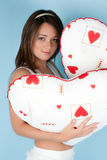Beautiful young woman with two pillows Royalty Free Stock Photography
