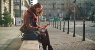 Attractive brunette young woman using phone in a city. stock photo
