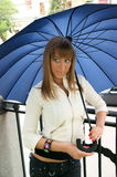 Beautiful young woman with umbrella Stock Images