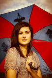 Beautiful, young woman and umbrella Royalty Free Stock Photography