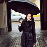 Beautiful young woman with umbrella - outdoor royalty free stock photo