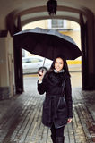 Beautiful young woman with umbrella Royalty Free Stock Photos