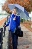 Beautiful young woman with umbrella on rainy autumn day Royalty Free Stock Photos
