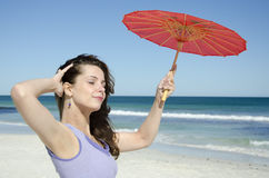 Beautiful young woman with umbrella at sea Royalty Free Stock Image