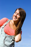 Beautiful young woman under blue sky. Portrait Royalty Free Stock Photography