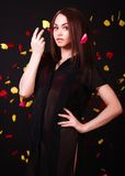 Beautiful young woman under the falling petals Royalty Free Stock Images