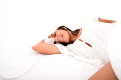 A beautiful young woman under the sheets in the bed Royalty Free Stock Photography