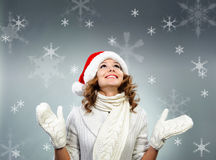 Beautiful young woman under white snowflakes Stock Image