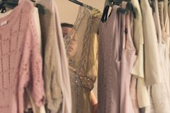 Beautiful young woman in the underwear choosing what to wear standing in front of her wardrobe early morning stock image